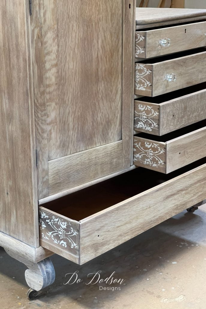 I just love the look of a stenciled pattern when applied to the side of a drawer. Just enough detail that doesn't take away from the beautiful wood finish.