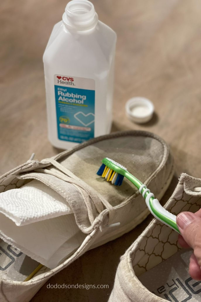 Once the fabric fibers are wet, they will open up and swell. That's a good thing, and the toothbrush bristles get right on in there and get the job done to break up the dried paint. This is how I get dried paint out of clothes and shoes.