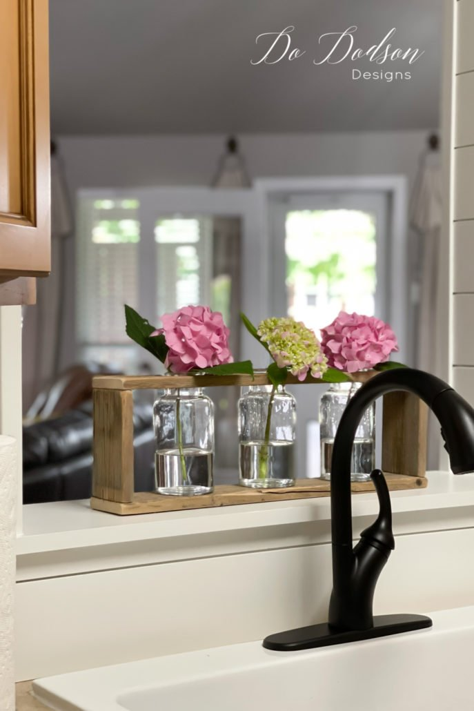Oh my goodness, these are too stinking cute! Immediately I placed the wood vase holder in the opening of my kitchen passthrough. L-O-V-E them so much! Now I can enjoy my beautiful hydrangeas all day inside and out.