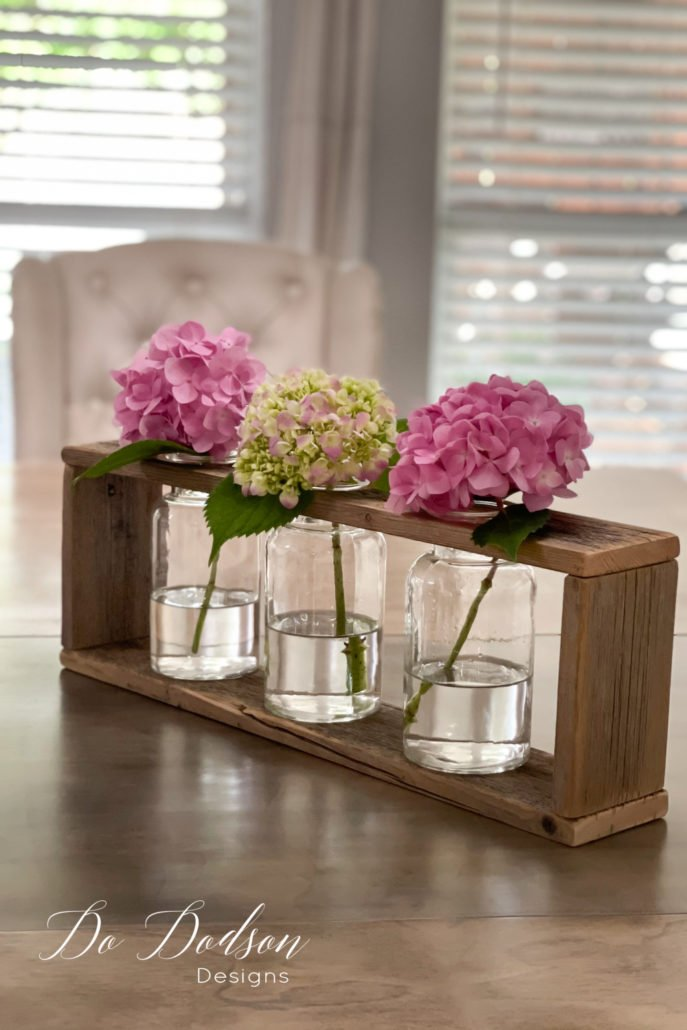 This DIY wood vase holder looks beautiful on my dining room table. I was literally running around placing them all over my home. It's the little DIY things that make me happy. Learn how I did it on the blog.