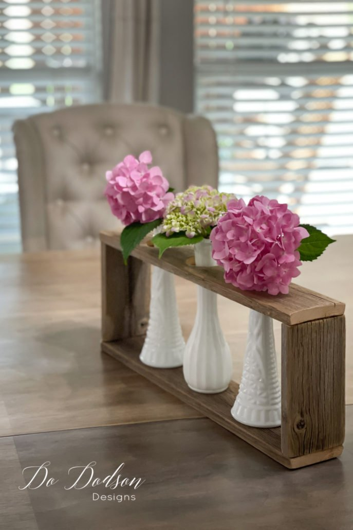 So, I created a second wood vase holder and used some milk glass bud vases. These are adorable too! I have this vision of colored vases too. Learn how to make these on my blog.