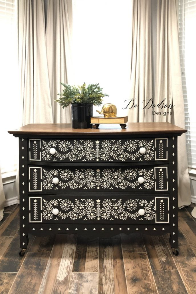 Here we have one of my favorite black-painted inspired pieces of furniture. This loveliness of stenciled art gives this dresser some real character. Learn how I did it on the blog.
