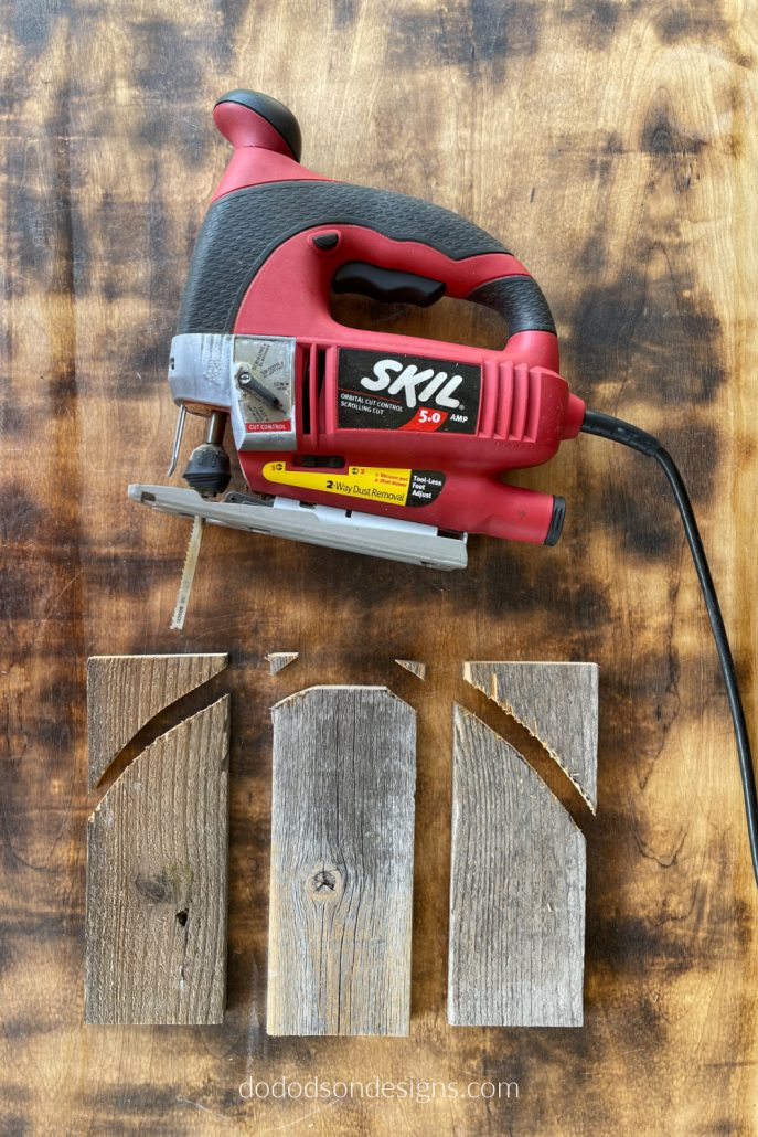 Use a jig saw to cut away the extra wood from your rustic pumpkins. This will give them shape after attaching them together. They're going to be so cute!