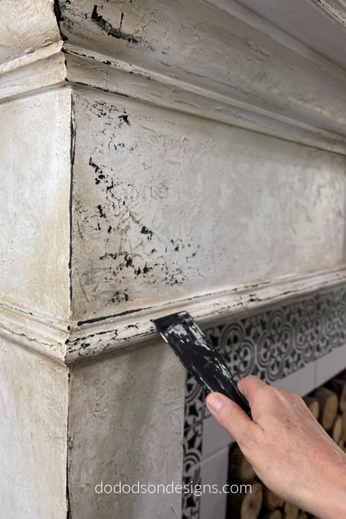 This faux chippy paint look is easily obtainable and not only looks great on furniture but I used this technique on my fireplace as well.