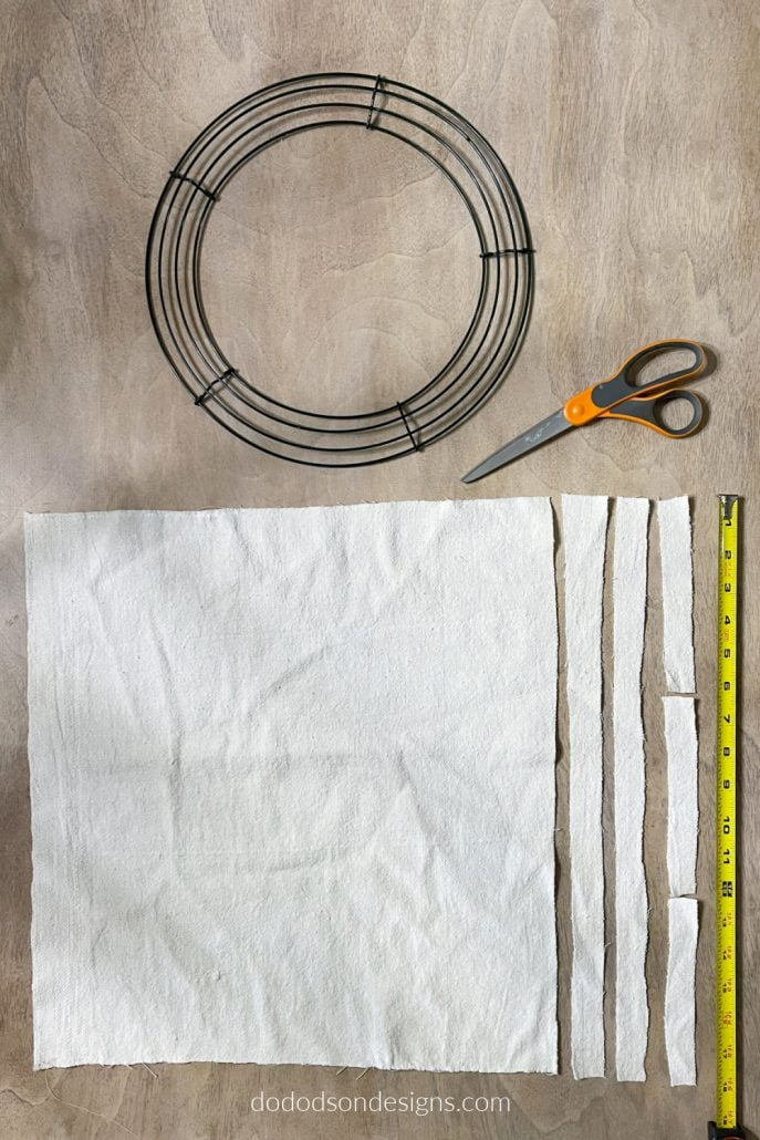 Here is everything you'll need to make a DIY drop cloth wreath. It takes less than an hour and the results are gorgeous!