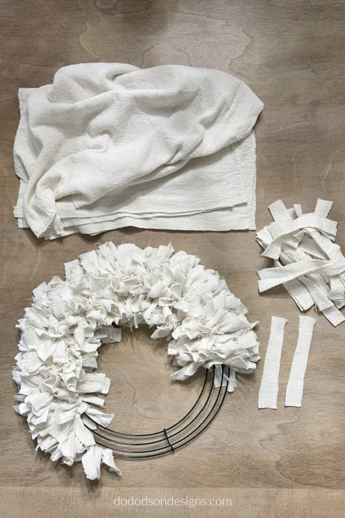 I made this gorgeous DIY drop cloth wreath in less than an hour with items I already had in my craft room. It feels so good to use up those scraps of fabric.
